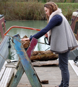 Emily cutting logs